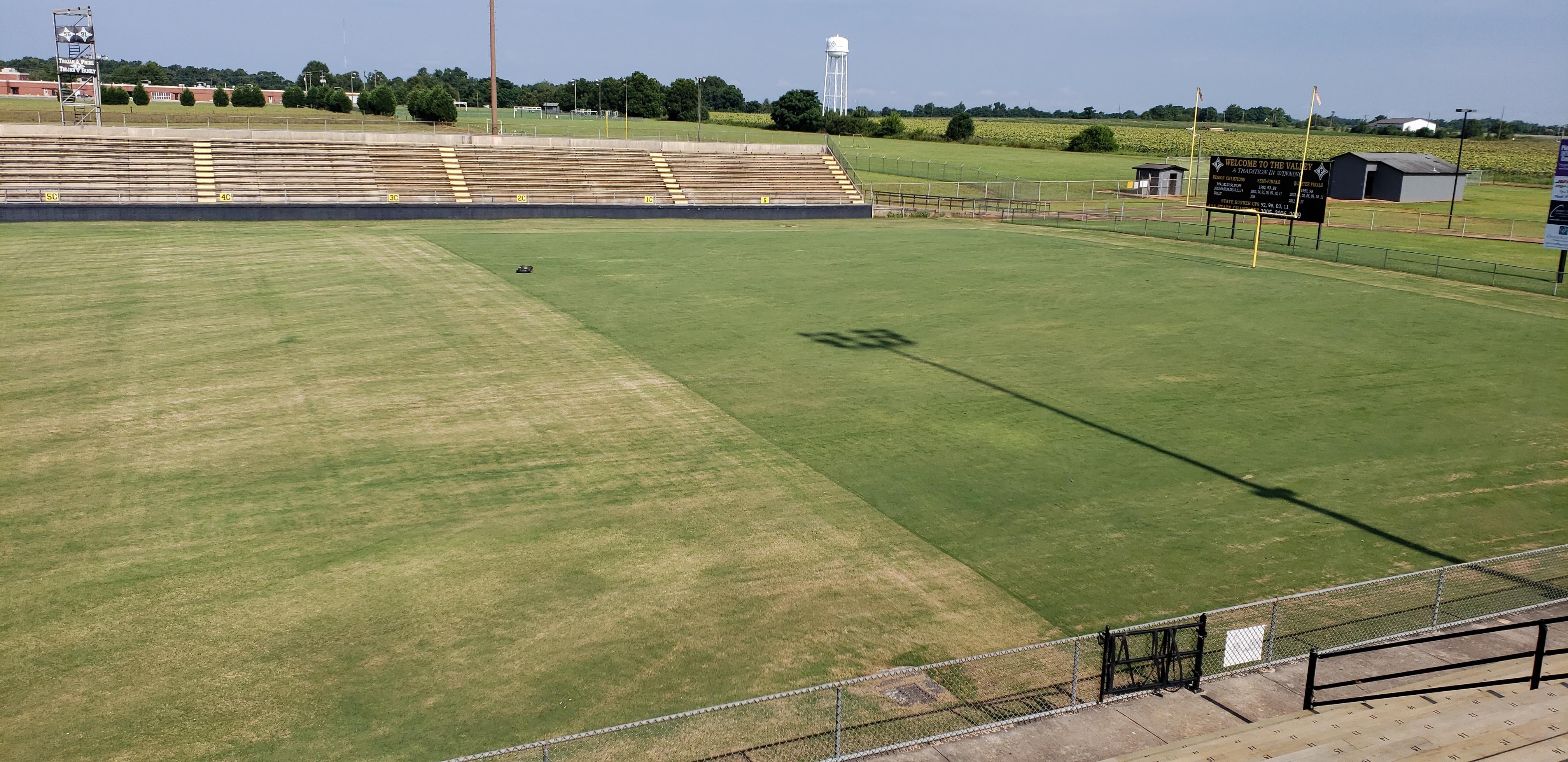 1 week of automower vs. reel mower on a football field