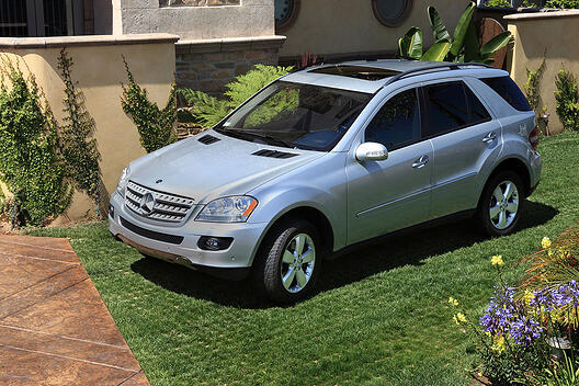Drivable Grass with sod and a Mercedes parked on it