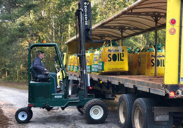 Delivery Driver unloading BigYellowBags of Soil3 compost