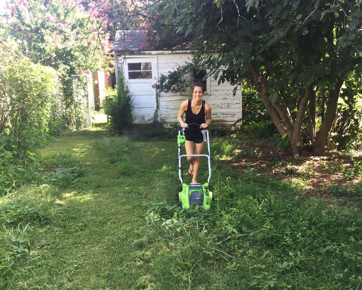 andrea mowing weeds during lawn restoration-558899-edited.jpg